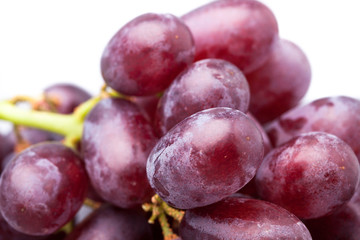 Bunch of red grapes, close-up on a white background