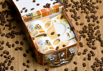 cups for coffee with coffee beans