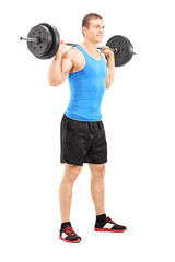 Young man lifting a barbell