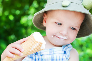 happy toddler boy eating ice cream
