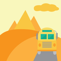 Bus on desert with pyramids