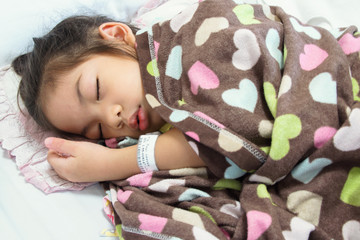 Young Baby Girl as Patient Sleeping on Hospital Bed