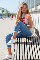 Beautiful girl in torn jeans