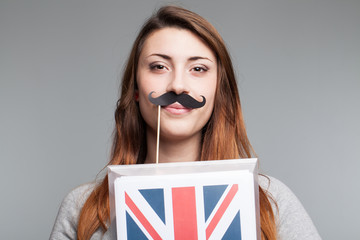 smiling young woman with British flag