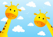 Funny giraffes on sky background