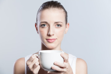 woman holding a coffee cup