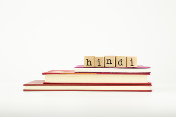 hindi language word on wood stamps and books
