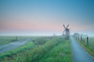 beautiful misty sunrise over Dutch farmland