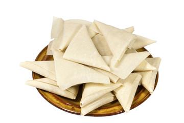Brown Plate of Freshly Folded Uncooked Samoosas