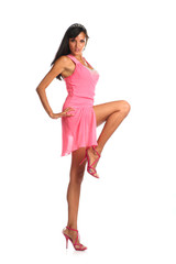 Full length of brunette female in pink dress posing