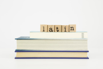 latin language word on wood stamps and books
