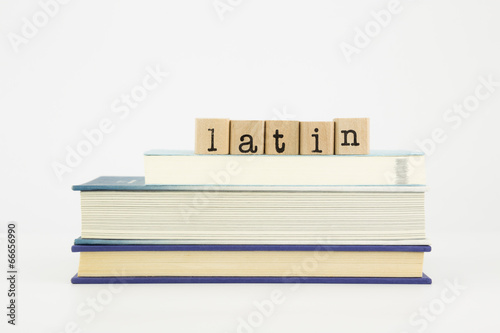 Aluminium Algerije latin language word on wood stamps and books