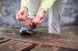 Female city runner lacing sport footwear