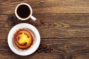 Cupcake and coffee on wooden table