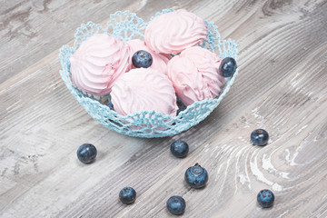 Meringue decorated with blueberries