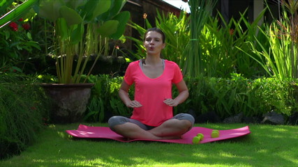 Woman doing breathing exercise in the garden
