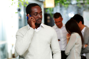 african businessman talking on the smartphone