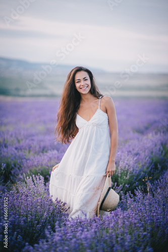 Beautiful young woman posing in a lavender field - 66659352