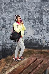 Sporty woman looking smartphone outdoor