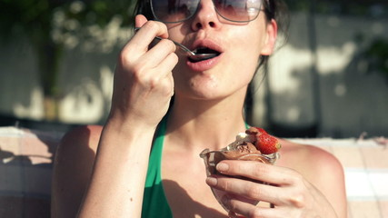 Sexy woman eating tasty ice cream