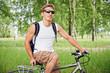 Smiling cyclist on bike