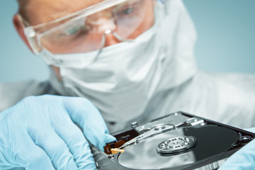 Scientist examines the hard disk