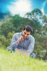 Happy young man with laptop, outdoor - outside