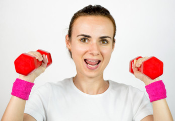 Young woman exercising with dumbbells, isolated