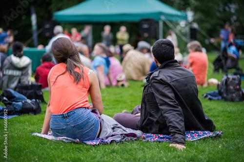 Friends enjoying an outdoors music community event, festival. - 66660952