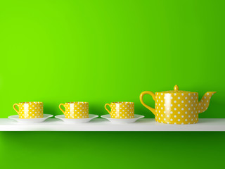 Yellow teapot and cups.