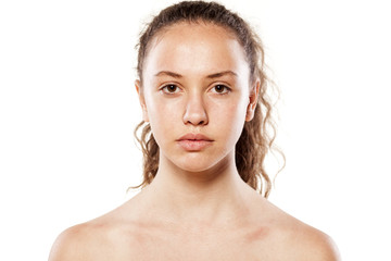 Serious young girl without makeup