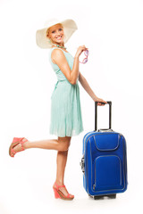 Woman with travel bag going to summer vacation on white