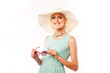 portrait of woman in hat and sunglasses on white background