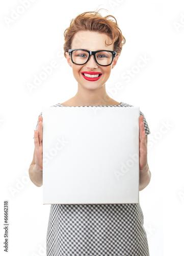 Smile female holding empty white board