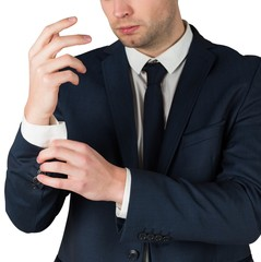 Handsome businessman adjusting his cuffs