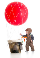 baby with pilot hat on hot air balloon