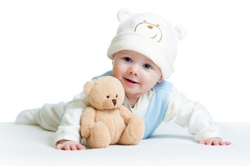 cute baby weared funny hat with plush toy
