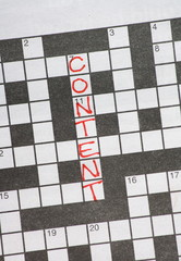 The word Content on a newspaper crossword puzzle