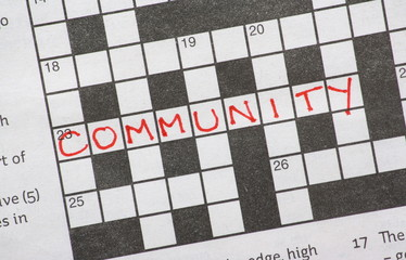 The word Community on a newspaper crossword puzzle