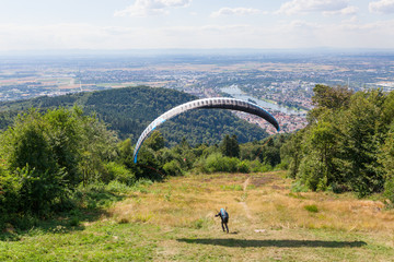 Paraglider running for take off
