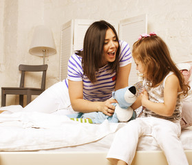young happy mother with daughter at home