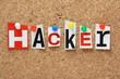The word Hacker on a cork notice board