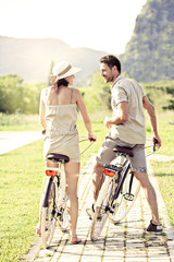 Couple in love have a ride with bicycles in the nature