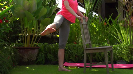 Woman exercising in garden, super slow motion, shot at 240fps
