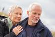 Leinwanddruck Bild - happy elderly senior couple walking on beach