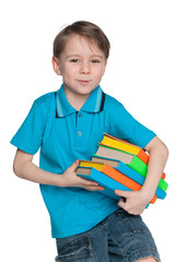 Smart little boy with books