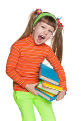 Shouting little girl with books