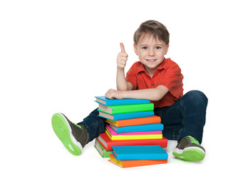 Sitting near books cheerful boy