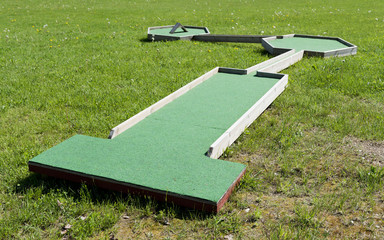 Small golf course built for children in a recreational space.