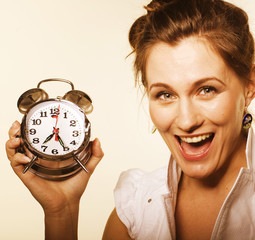 young pretty girl with alarm clock